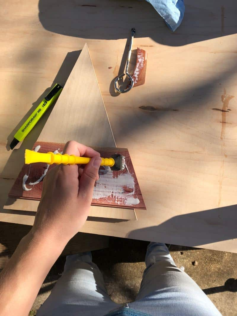 adding glue to cedar planks