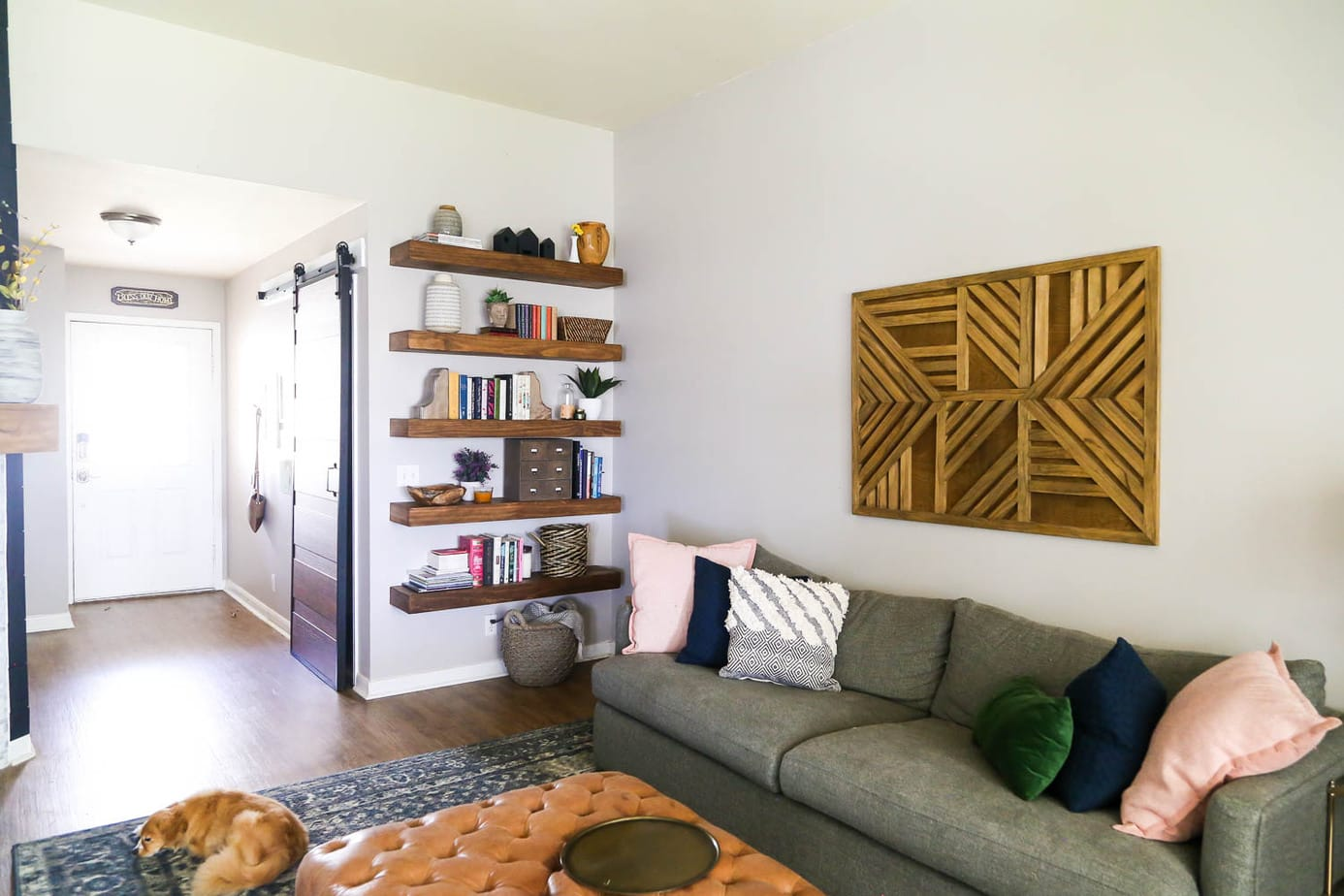 living room with floating shelves