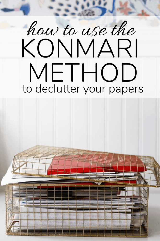 "box of paper with text overlay - ""how to use the konmari method to declutter your papers"""