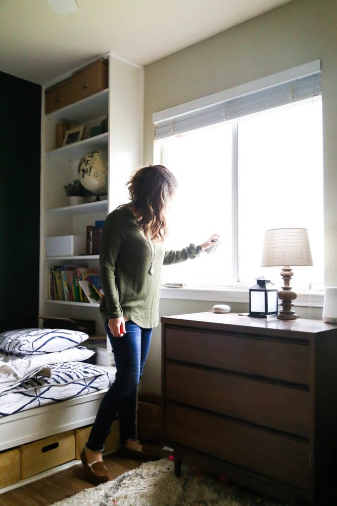 woman spraying 3-IN-ONE Lock Dry Lube on window locks