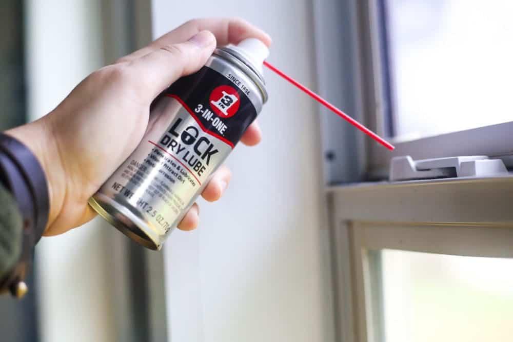 Lock Dry Lube being sprayed on window