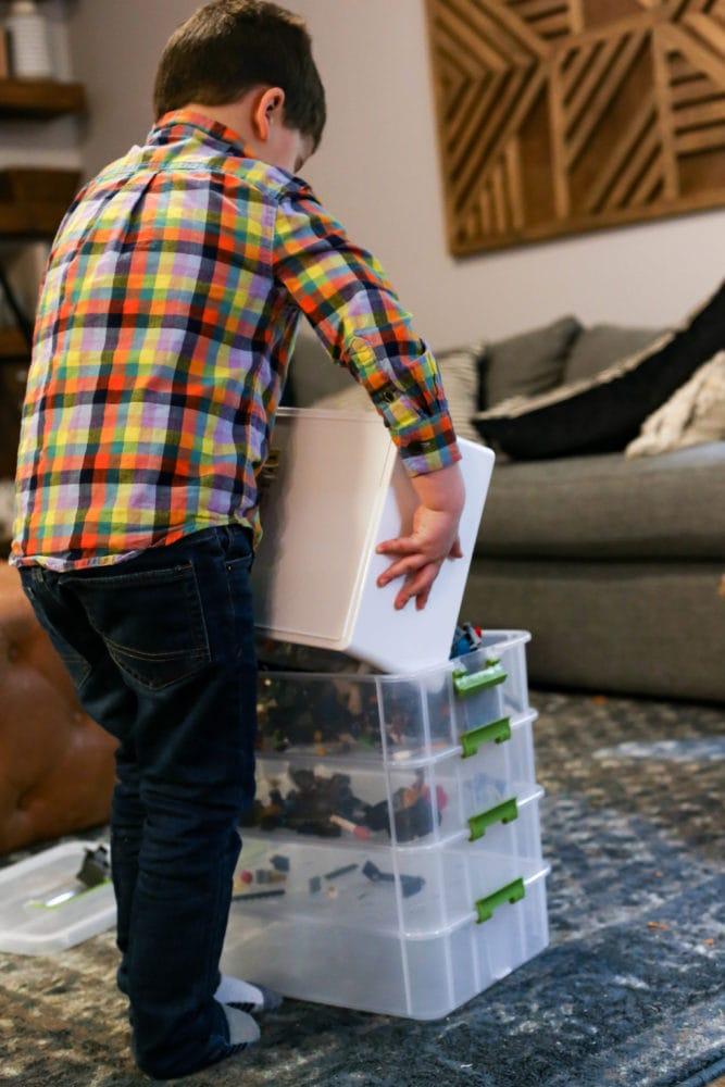 boy pouring LEGO bricks into DIY organizer