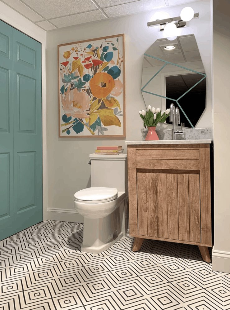 powder room with graphic tile and floral art