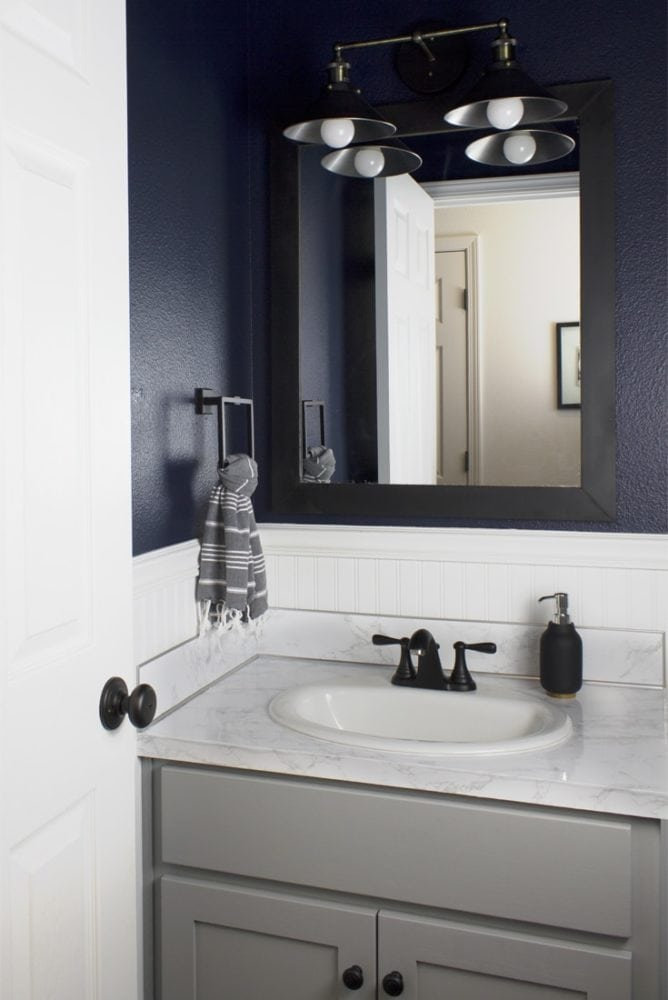 dark bathroom with navy walls