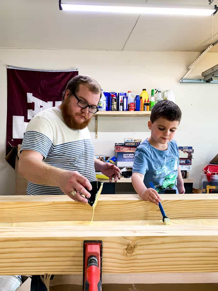father and son working together to build a workbench