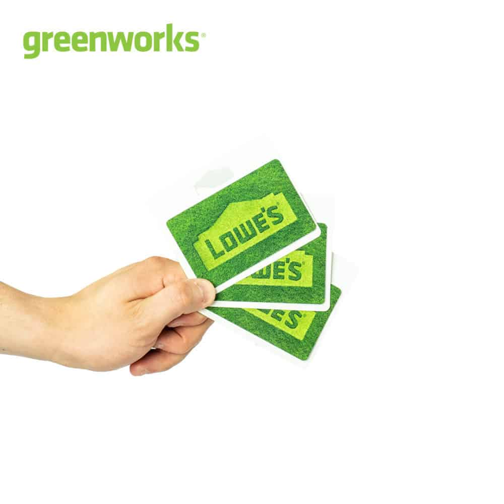 image of a hand holding Lowe's gift cards with Greenworks logo