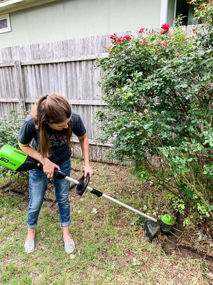 woman using a string trimmer