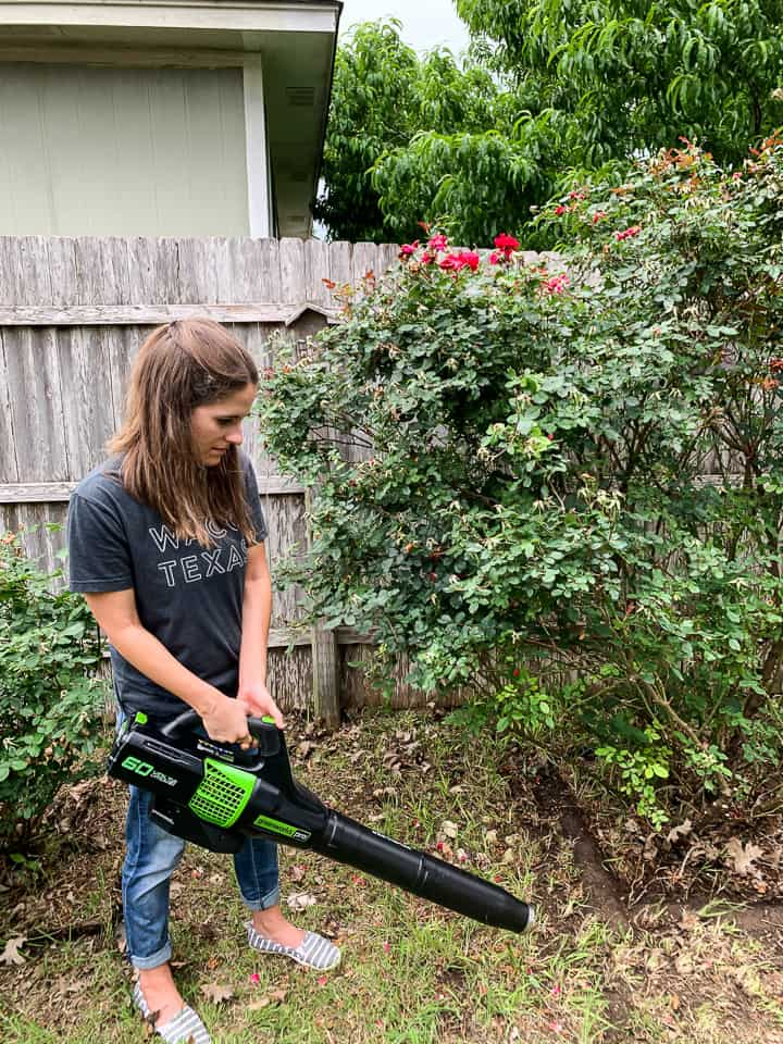 woman using a greenworks leaf blower