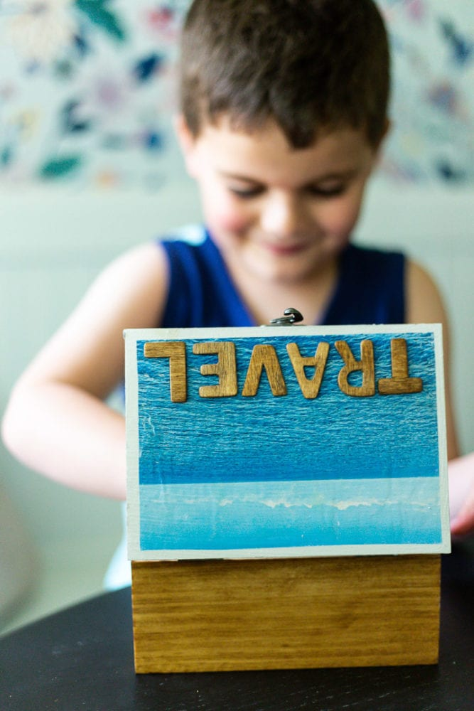 boy looking inside a DIY travel memory box