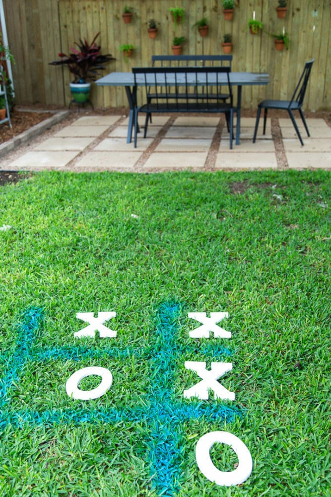 tic tac toe board drawn with spray chalk in the grass
