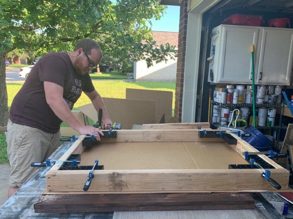 man assembling a table top