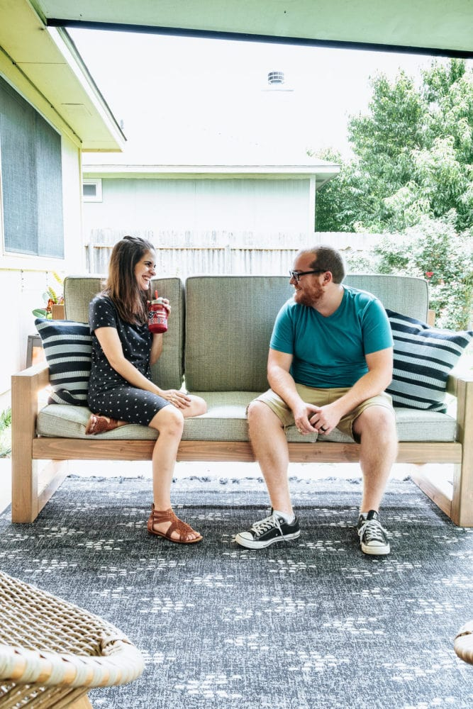 man and woman talking on a DIY outdoor sofa