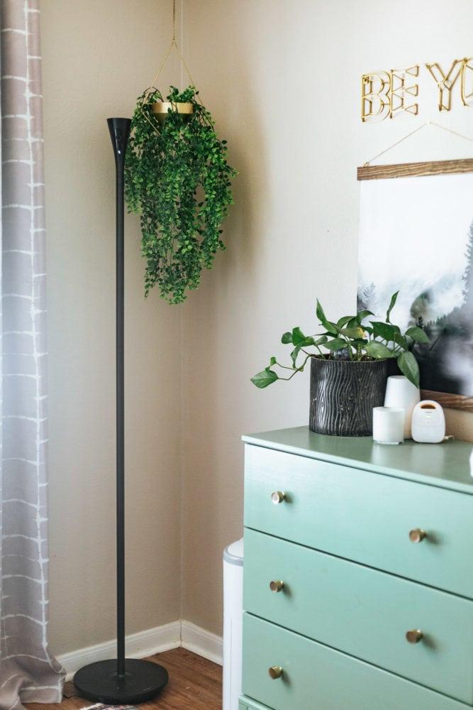 corner of a nursery with a Panasonic HomeHawk FLOOR standing lamp