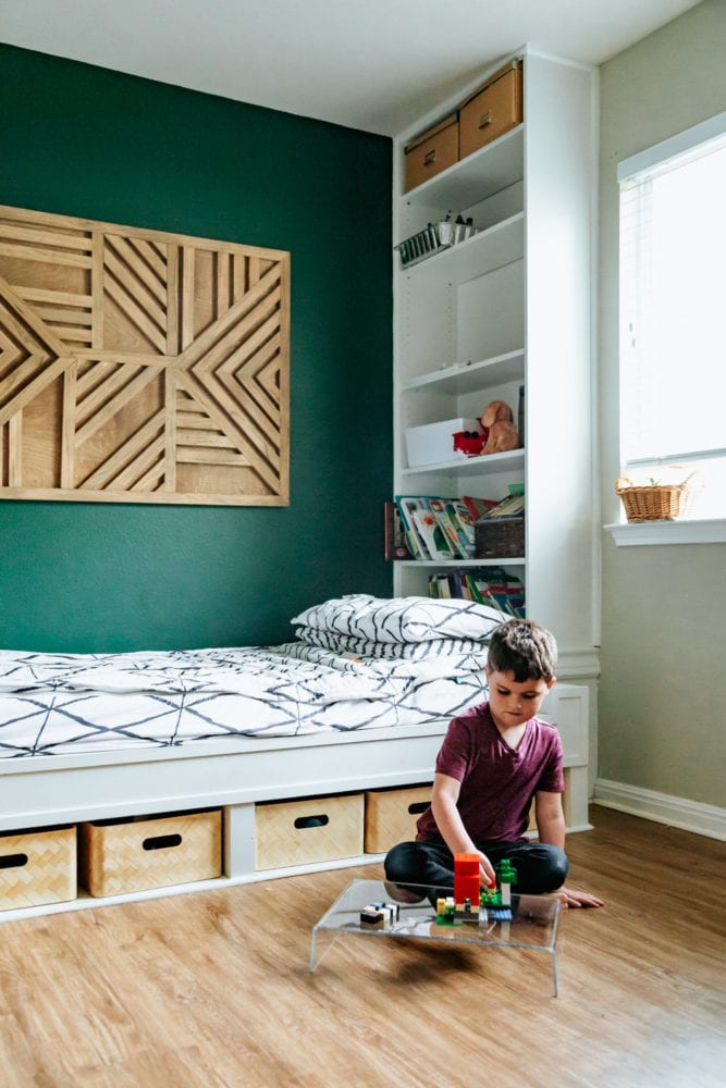 young boy playing on an acrylic lap desk in his bedroom