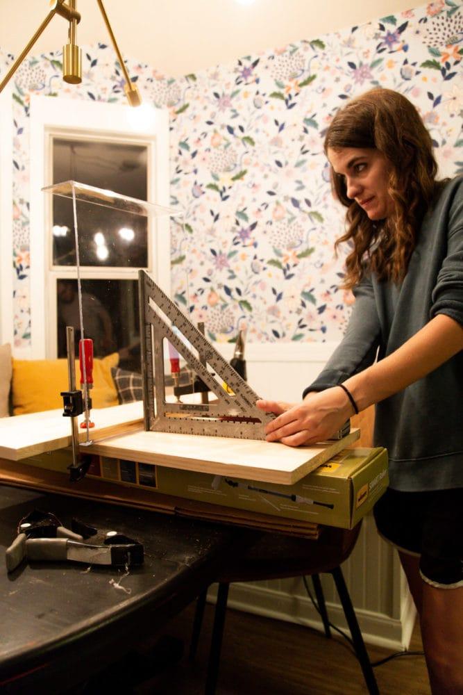 woman bending plexiglass to make DIY lap tray