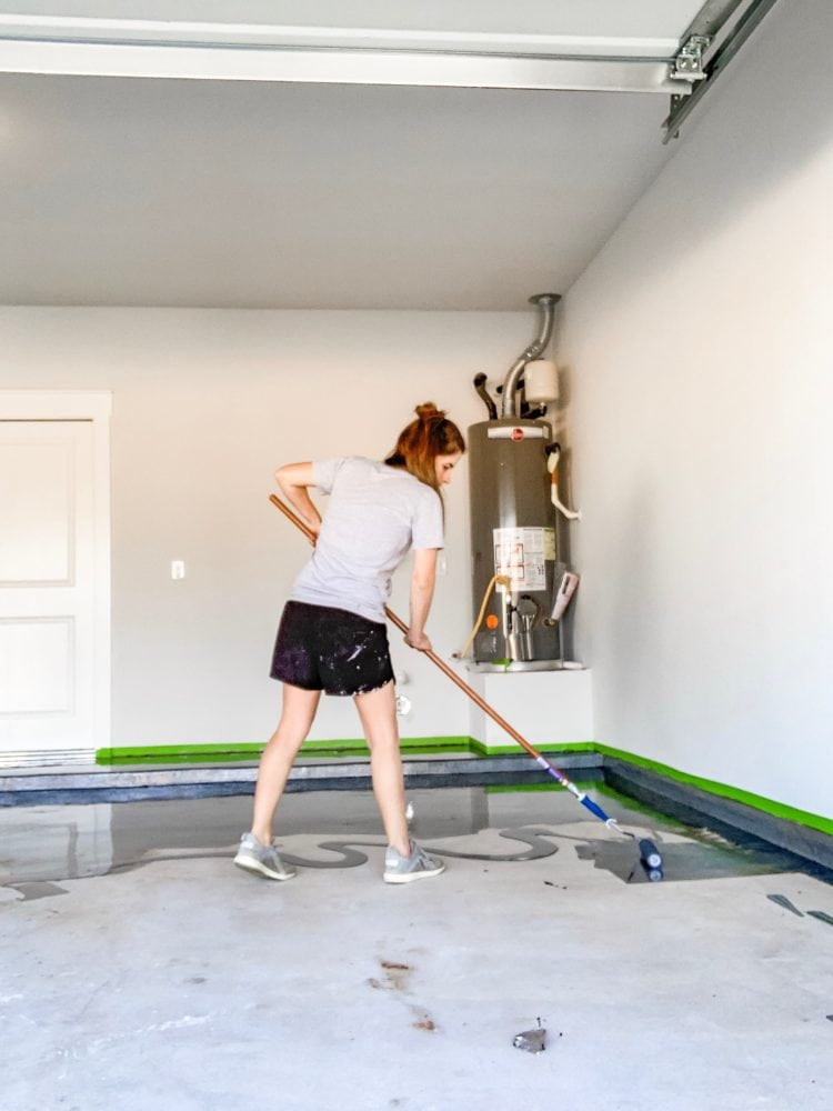 woman painting garage floor