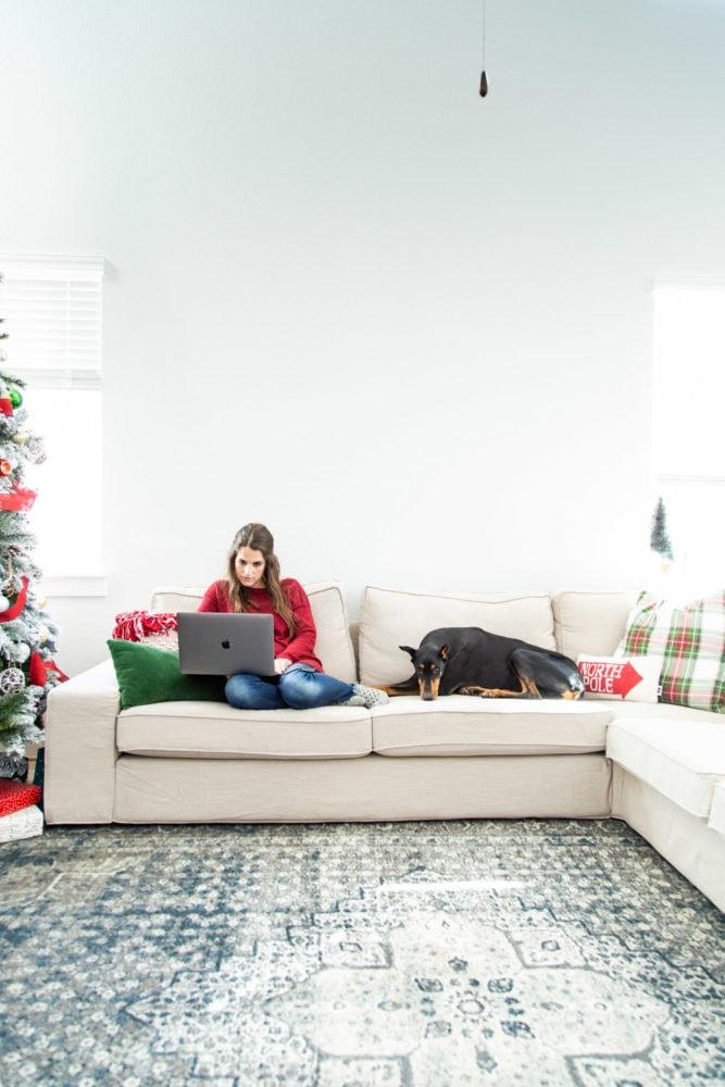 a woman and dog on an IKEA KIVIK sectional sofa