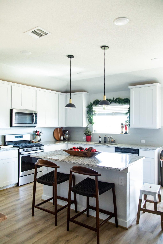 kitchen with black pendant lights