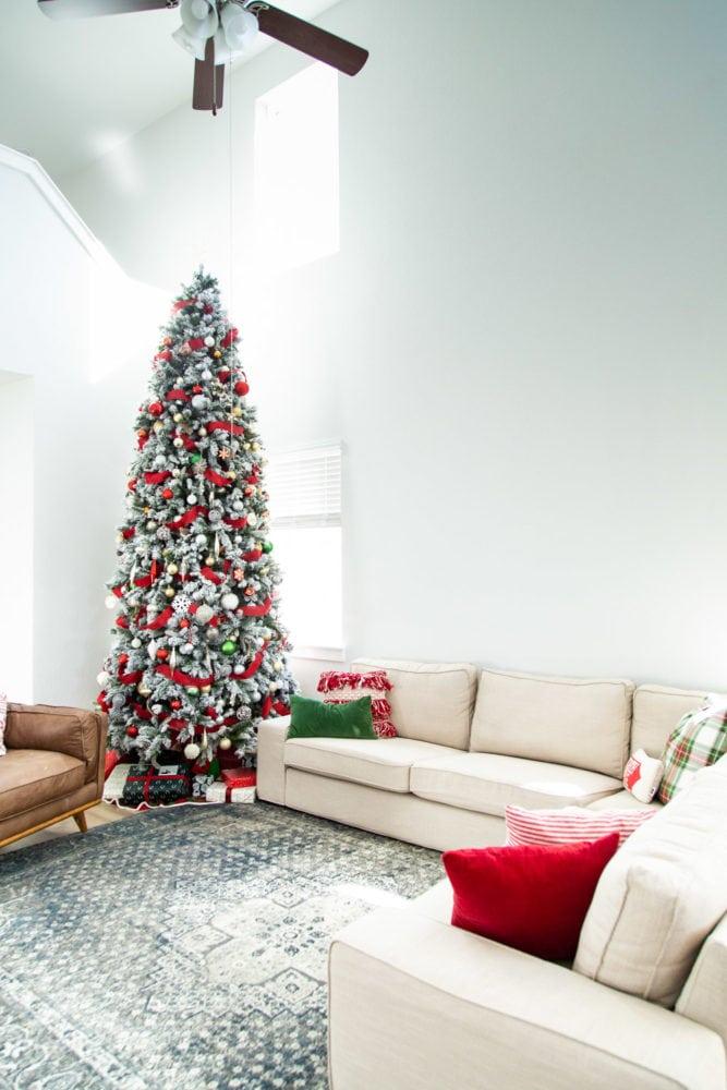 view of IKEA KIVIK sofa with a tall Christmas tree