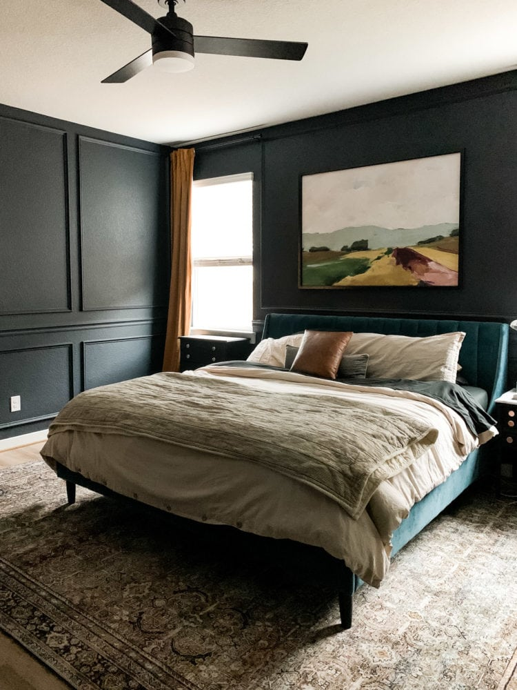 bedroom with dark trim and gold curtains