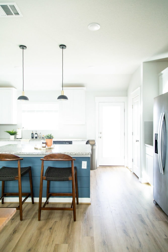 Kitchen with blue shiplapped kitchen island