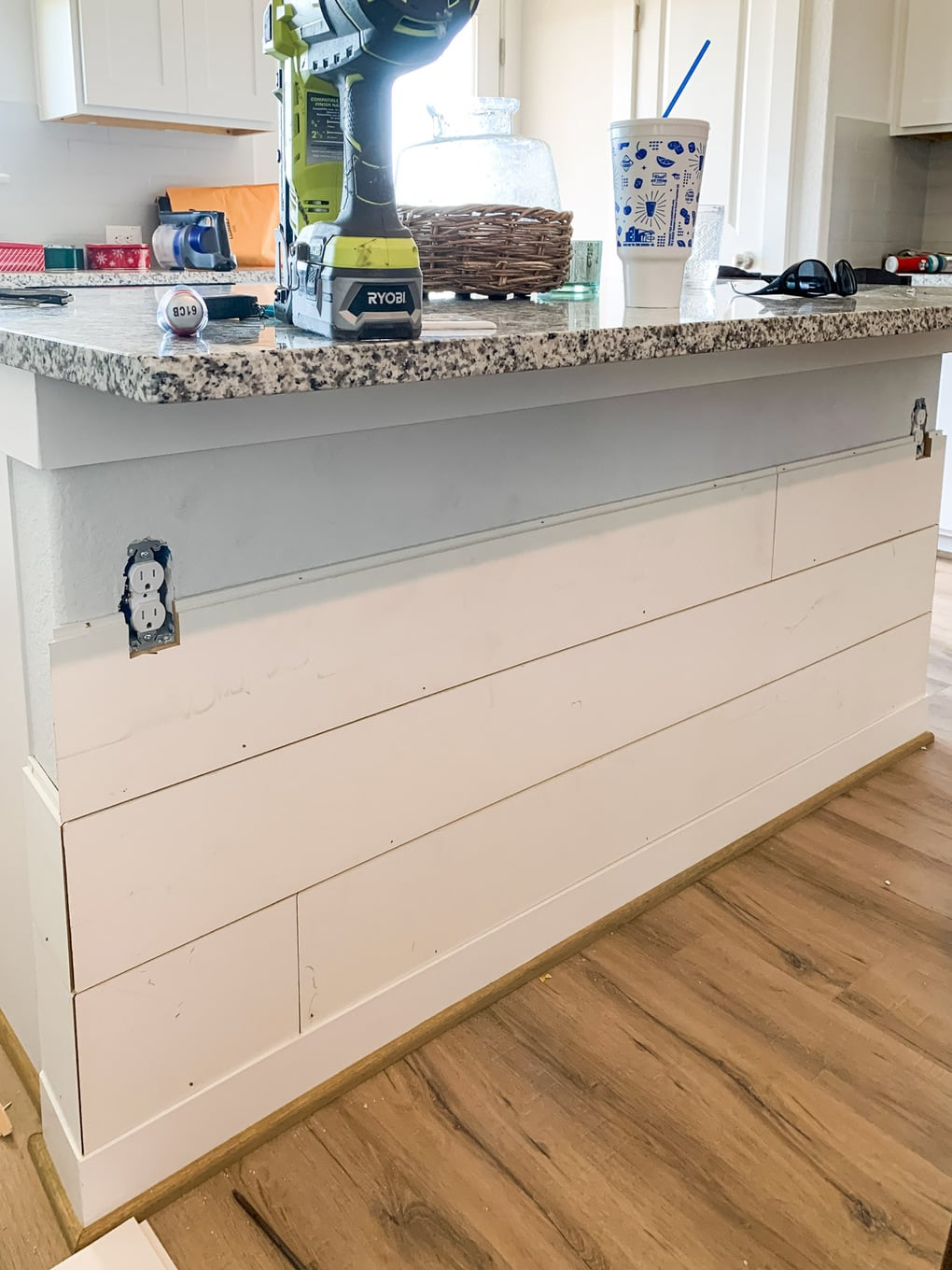 partially-installed shiplap on kitchen island