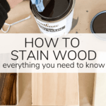 close up of woman staining wood with text overlay - how to stain wood everything you need to know