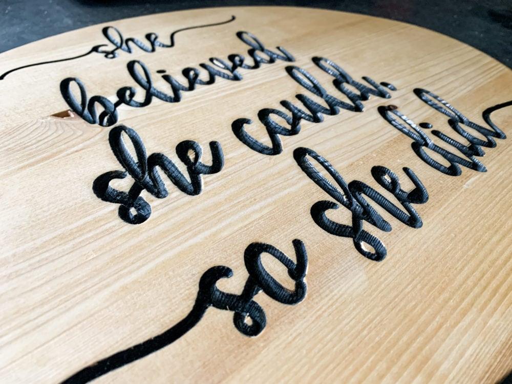 close up of DIY wood carved sign