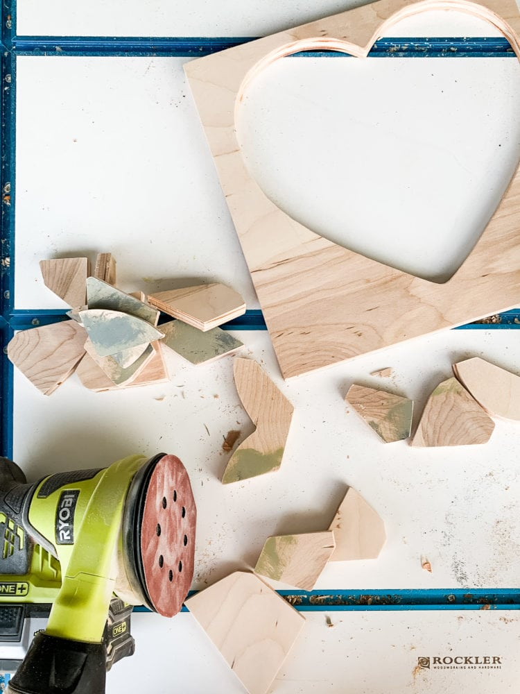 Pieces of DIY wood puzzle being sanded