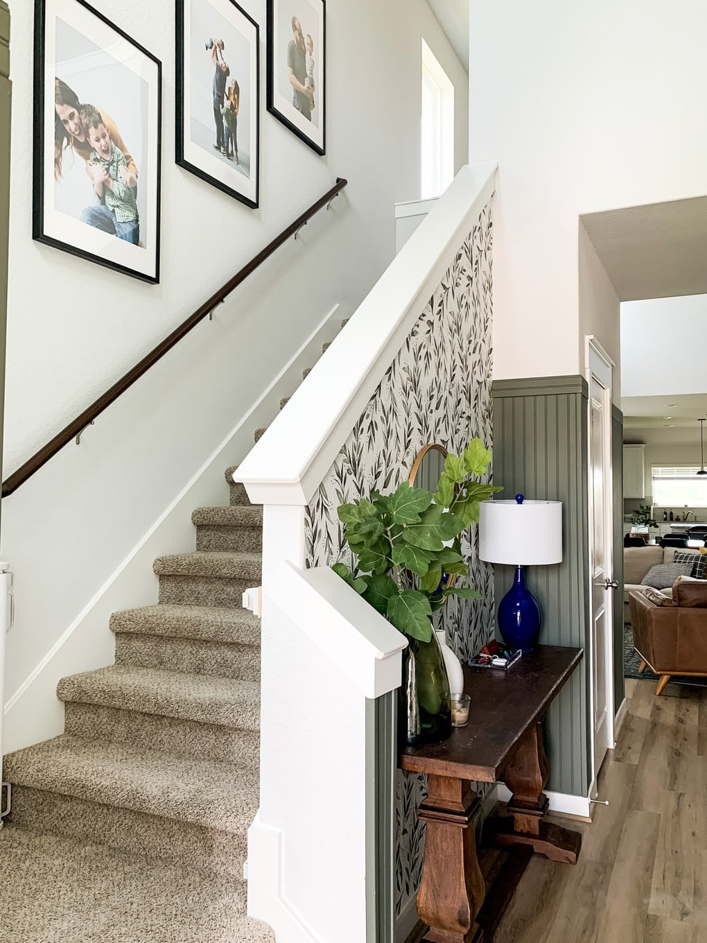 Entryway with photos going up staircase