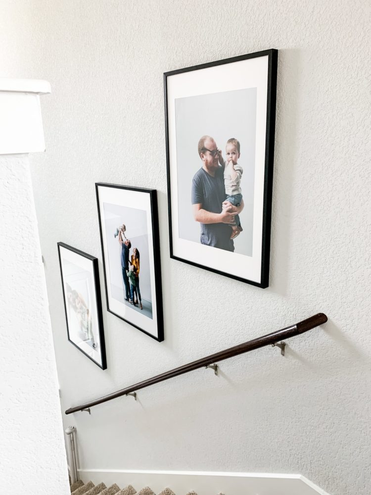 Trio of family photos in a stairwell