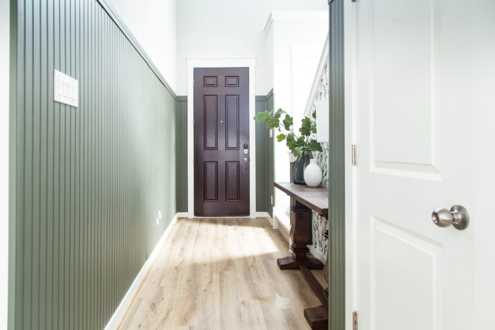 entry with dark green beadboard