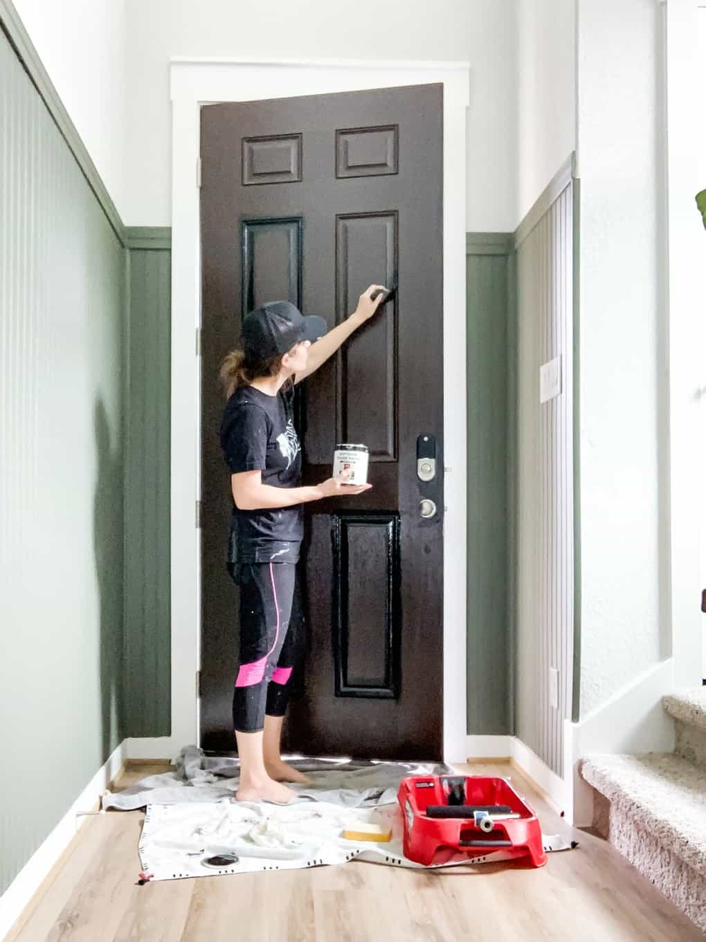 Woman painting a front door