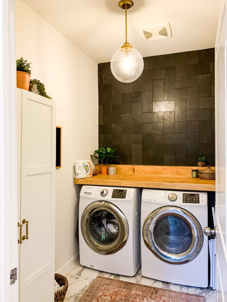 laundry room with basalt tile