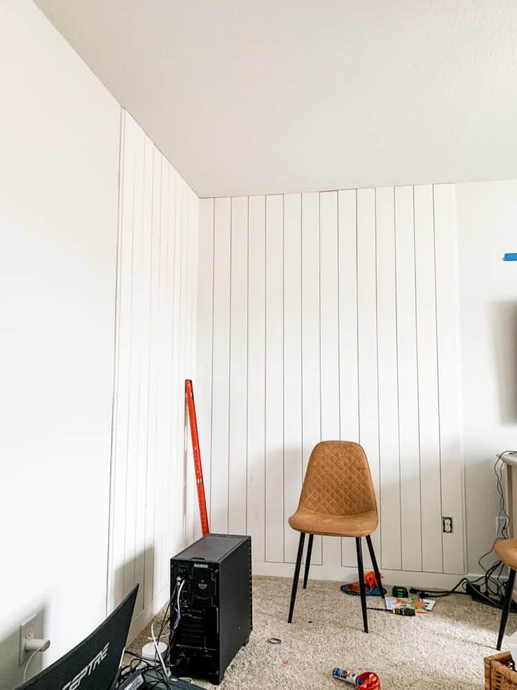 Corner of a room with vertical shiplap