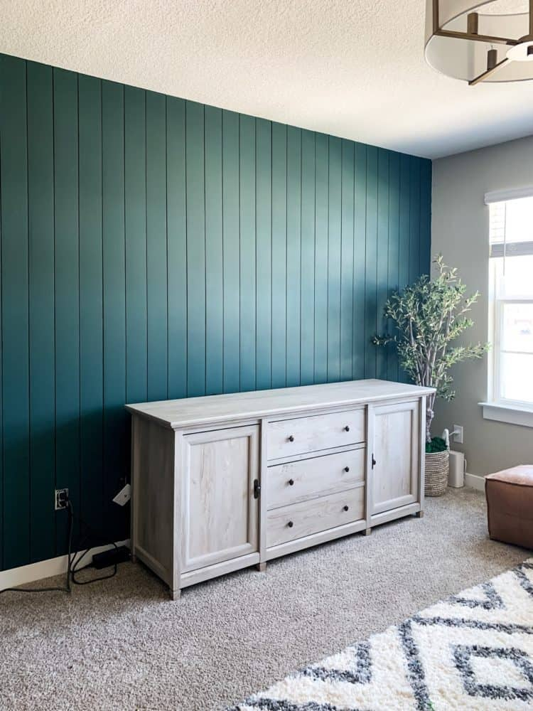 Wall with green vertical shiplap paneling