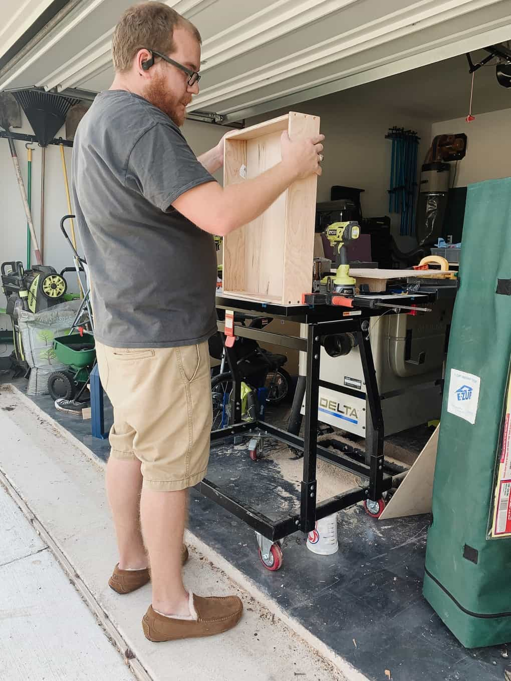 man assembling a drawer for a kitchen cabinet