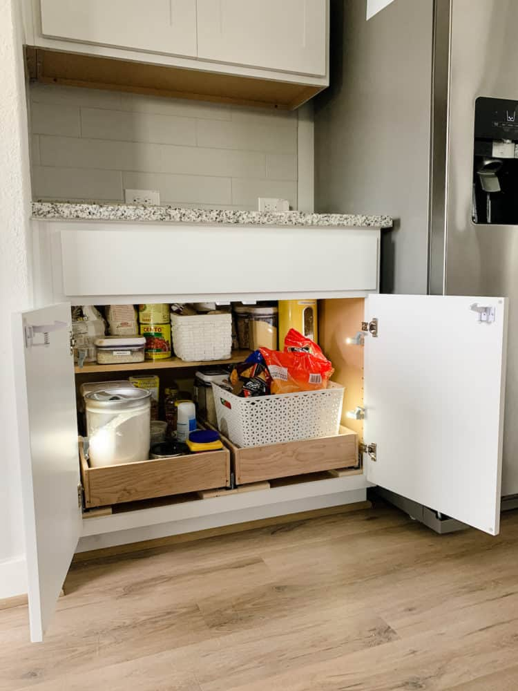 Kitchen cabinet with simple DIY pull-out drawers and hinge lights