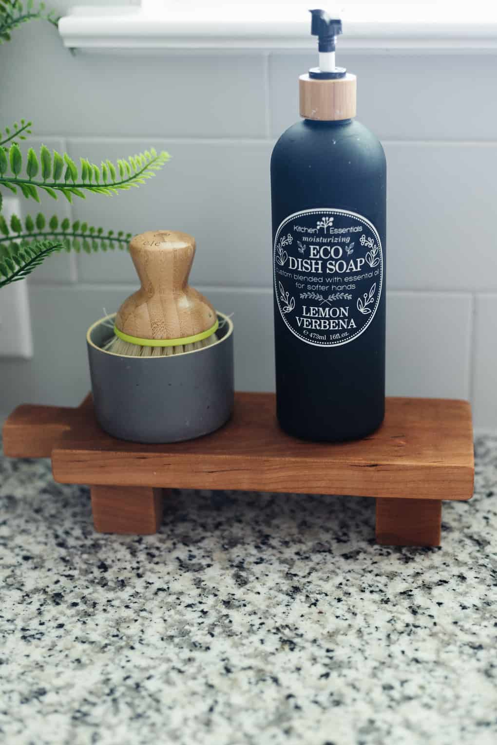 footed pedestal tray by kitchen sink