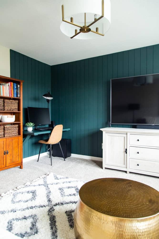 corner of bonus room with vertical shiplap