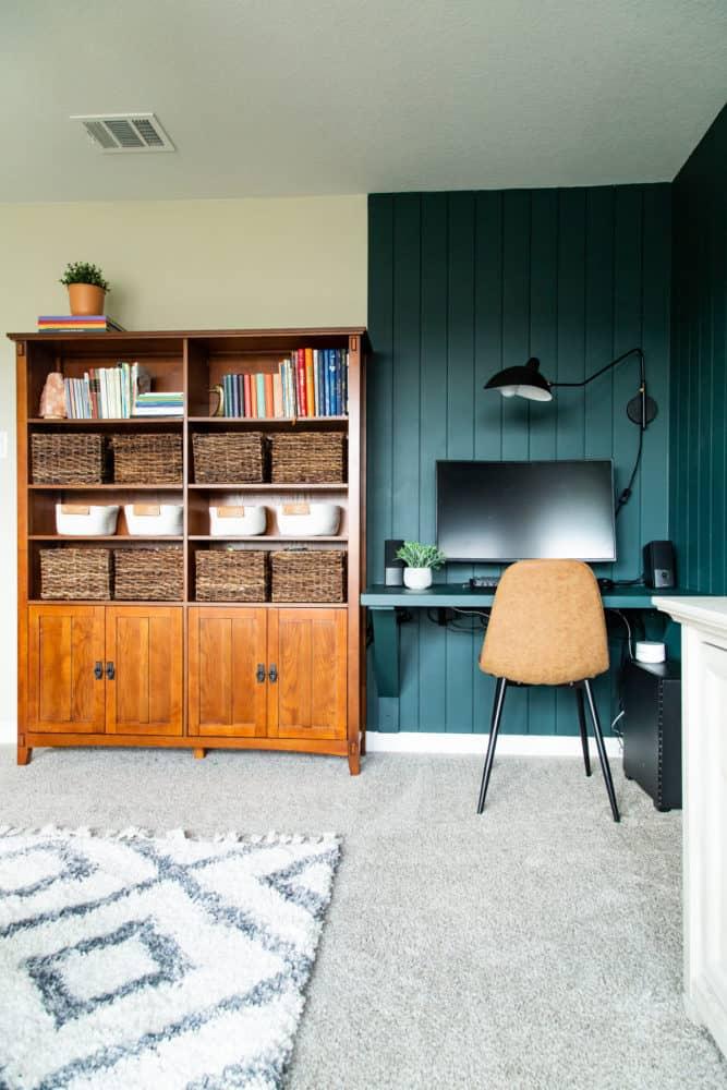 large bookcase and floating desk