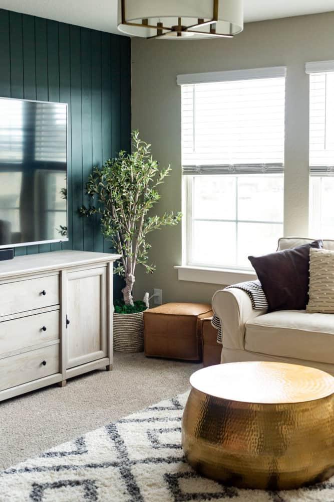 family room with dark green shiplap