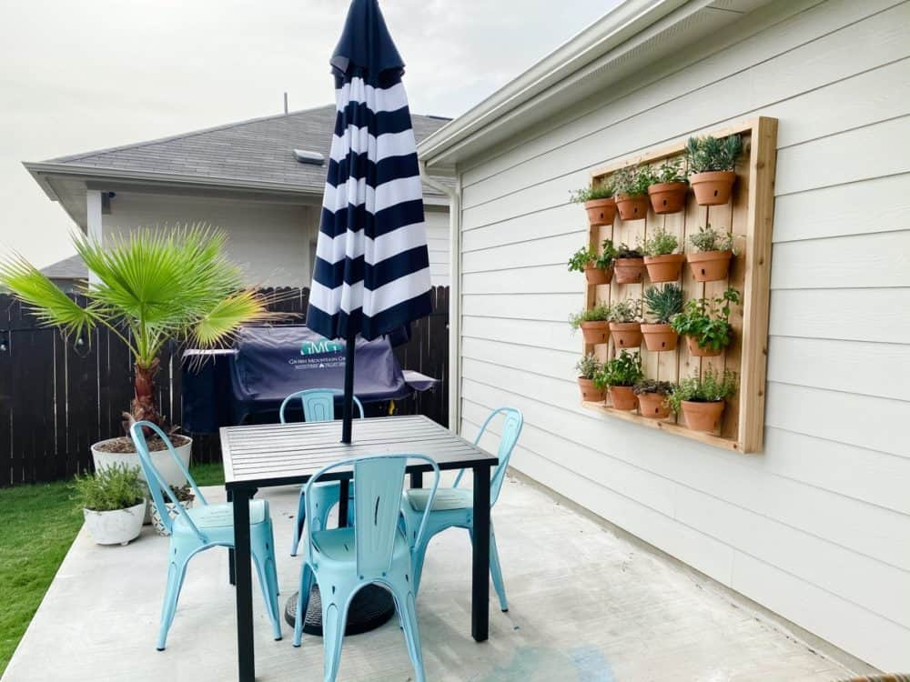 patio with a vertical hanging herb garden