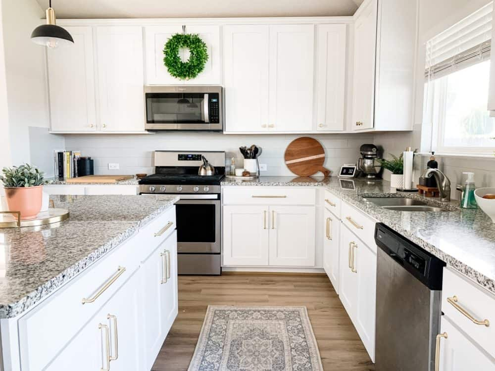 Kitchen with white. cabinets and gold hardware