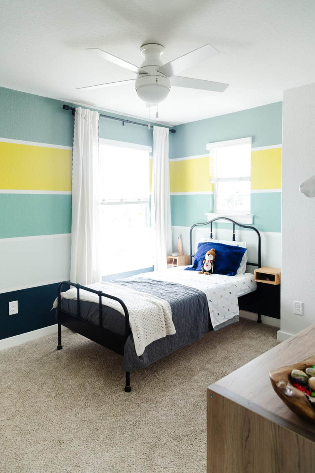 kid bedroom with bold and colorful stripes on the wall