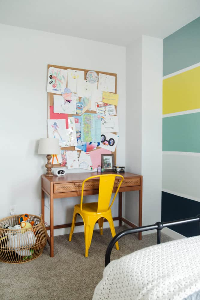kid room with desk and large bulletin board