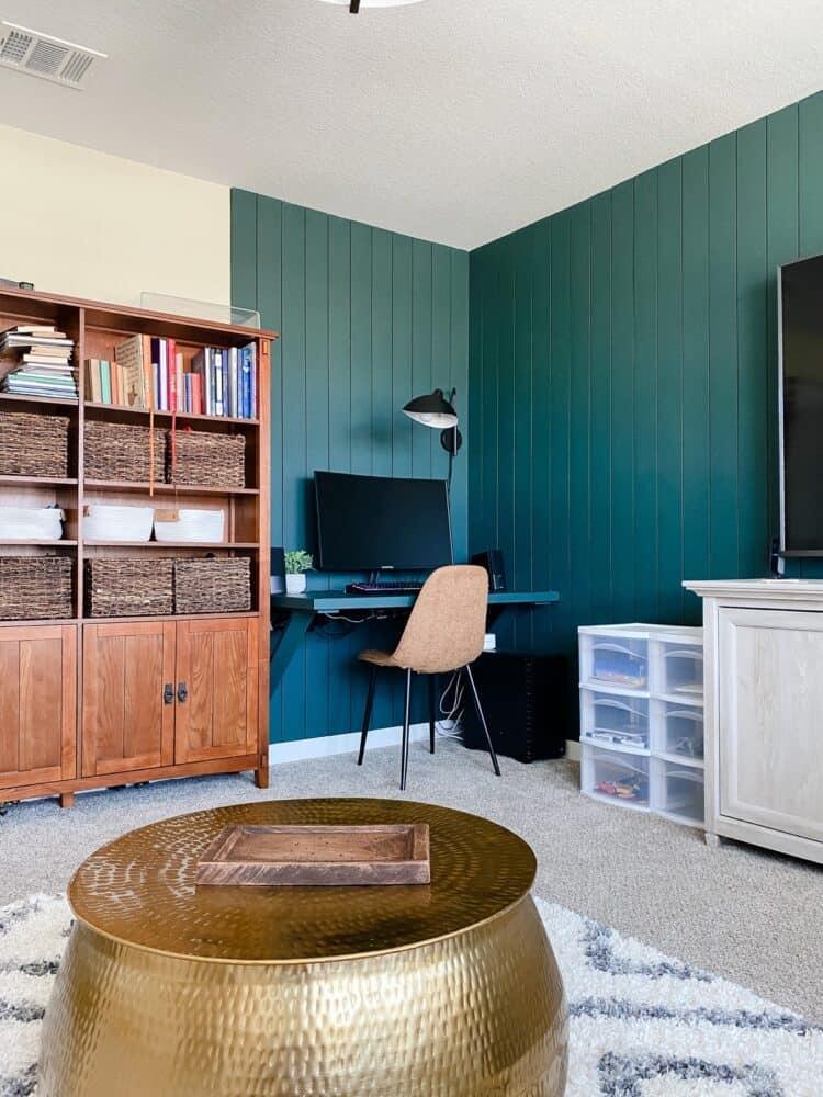 a corner floating desk in a family room