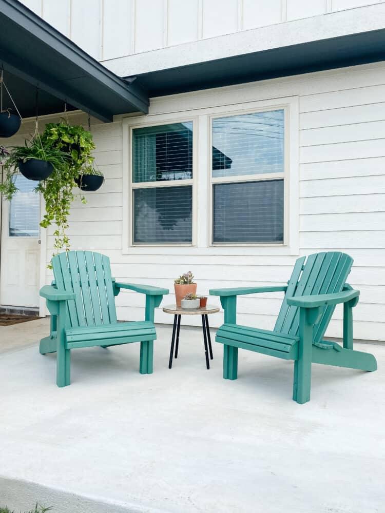 blue DIY Adirondack chairs on a patio