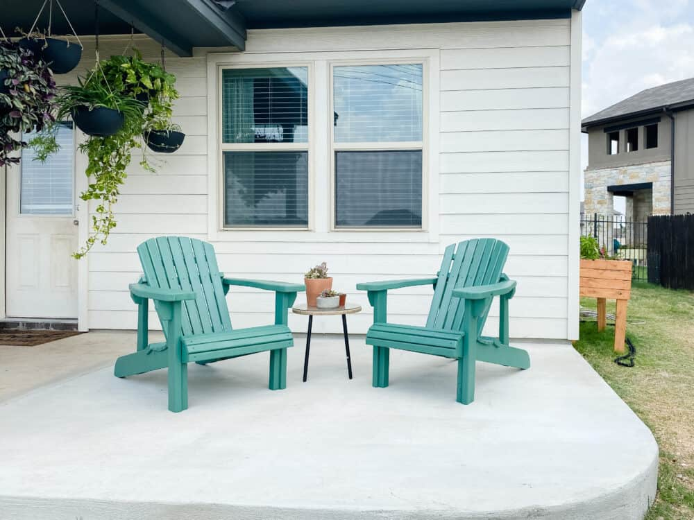 A small patio with DIY adirondack chairs