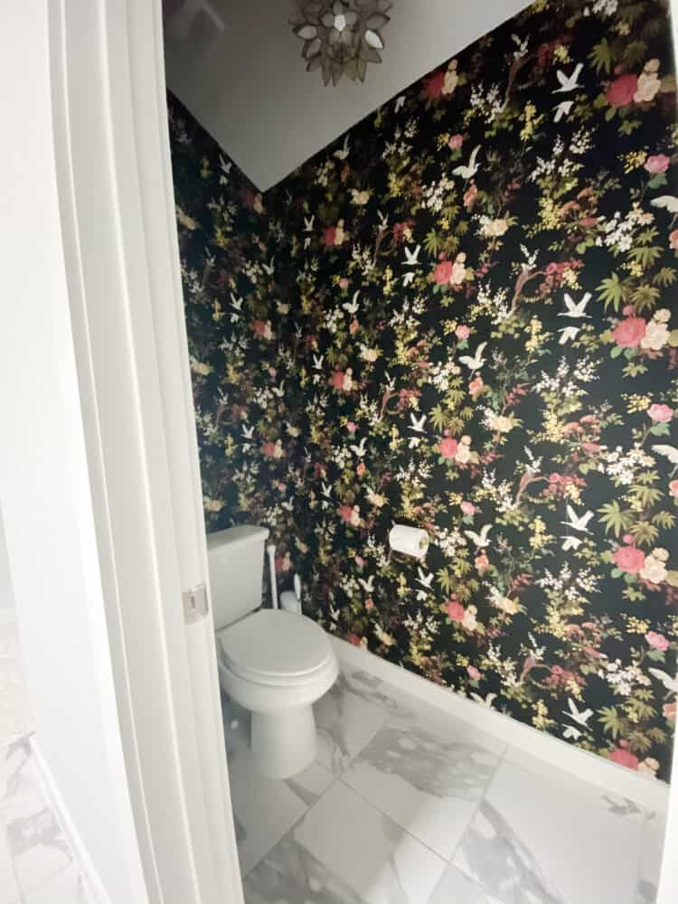 water closet with bold black floral wallpaper